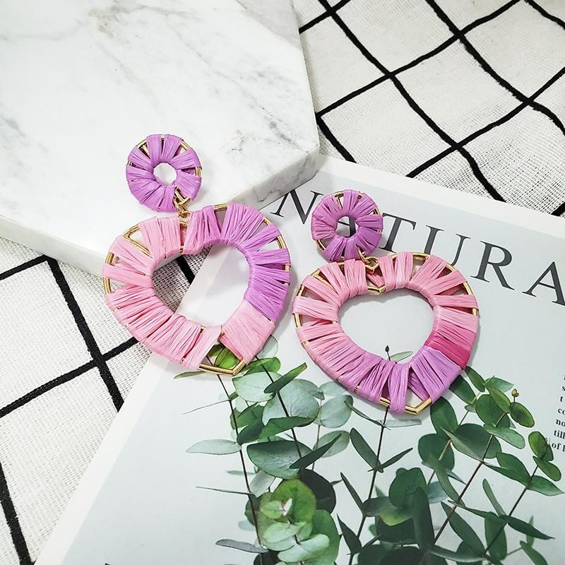 aretes morados y rosados en forma de corazón hechos con rafia y aleación para uso de año nuevo