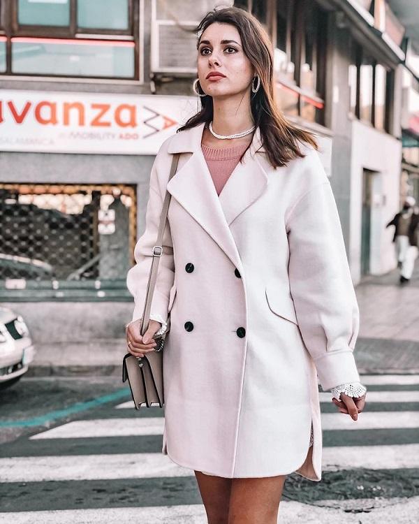 a women wear big hoop earrings on the street