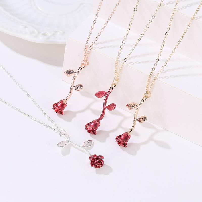 four rose shaped necklaces display