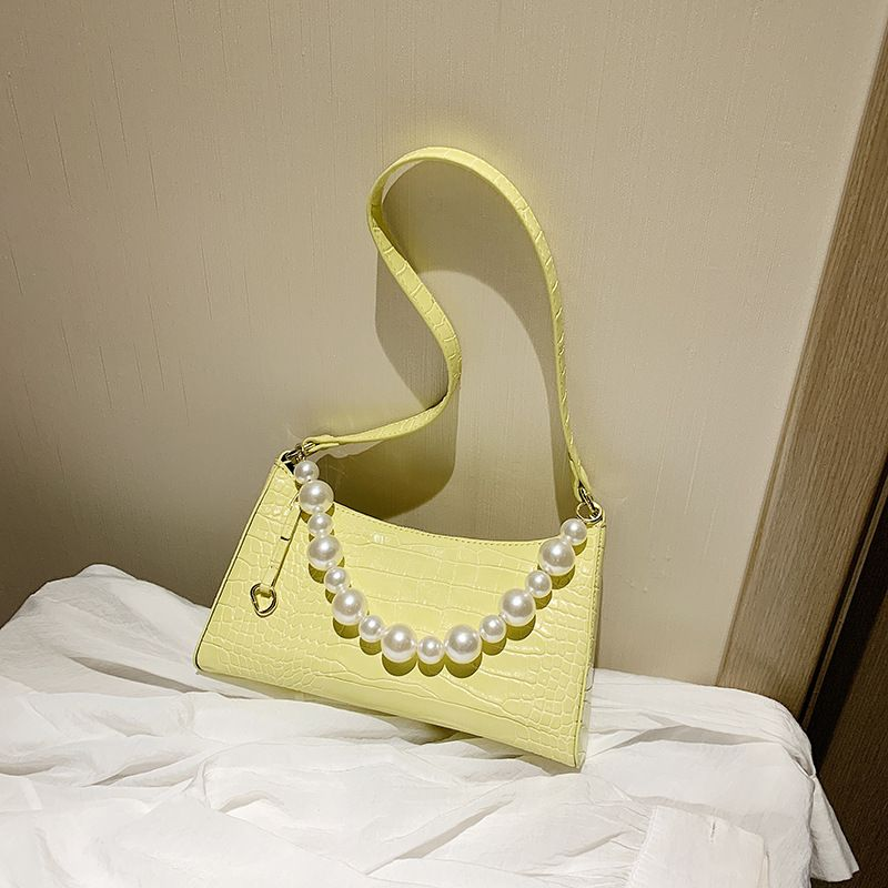 bright yellow underarm bag