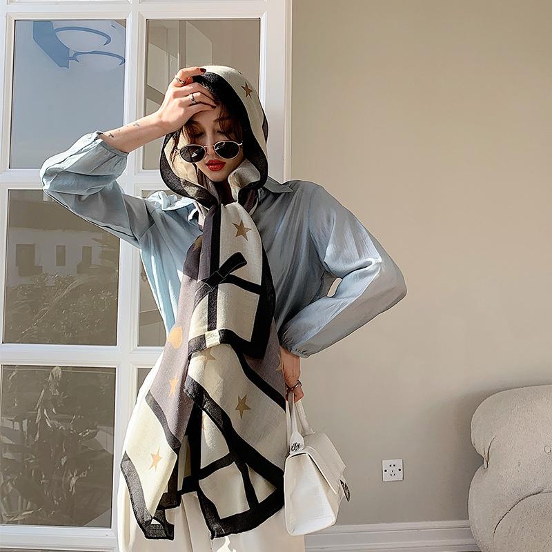 a women wearing long silk scarf